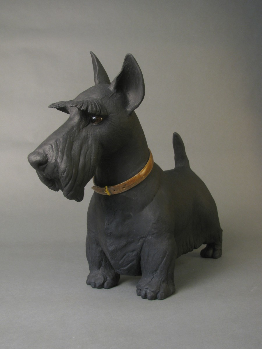 Ceramic Scooty dog sculpture